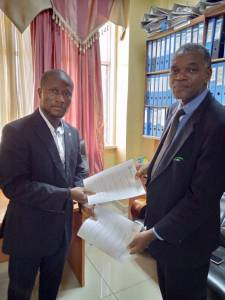 Mr Goprou (right), Monrovia, in the Ministry of Foreign Affairs, receiving the Cooperation Agreement